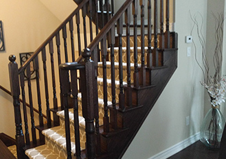 light brown carpet runner on dark staircase stair runner installation services in Toronto ontario