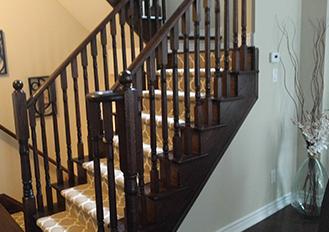 light brown carpet runner on dark staircase stair runner installation services in Toronto ontario